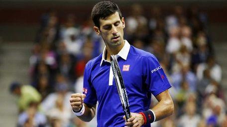 Novak Djokovic, of Serbia, reacts after winning a