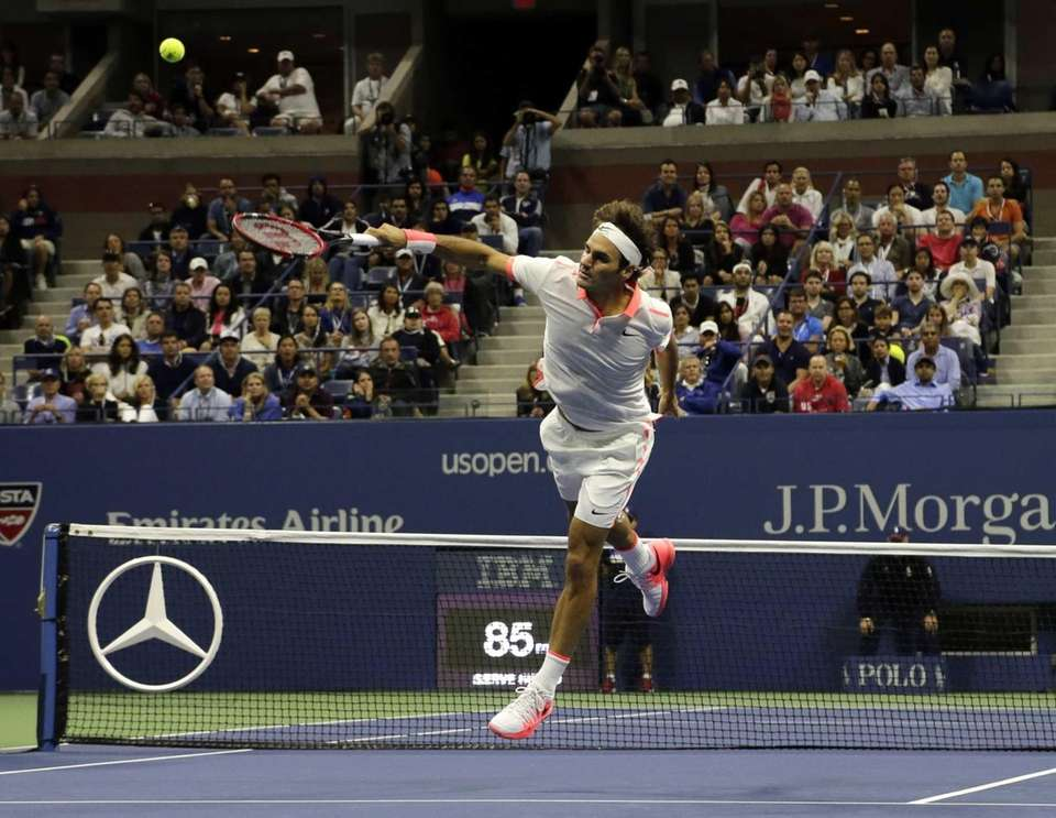 Roger Federer, of Switzerland, reaches to return a