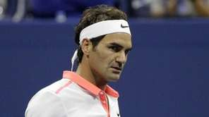 Roger Federer clenches his fist after a point