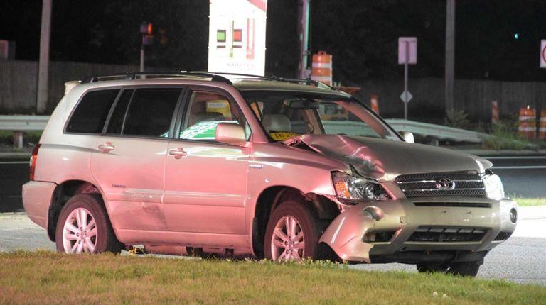 A 2007 Toyota Highlander, driven by a man,