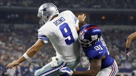 Dallas Cowboys quarterback Tony Romo (9) is sacked