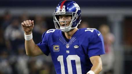 New York Giants quarterback Eli Manning (10) reacts
