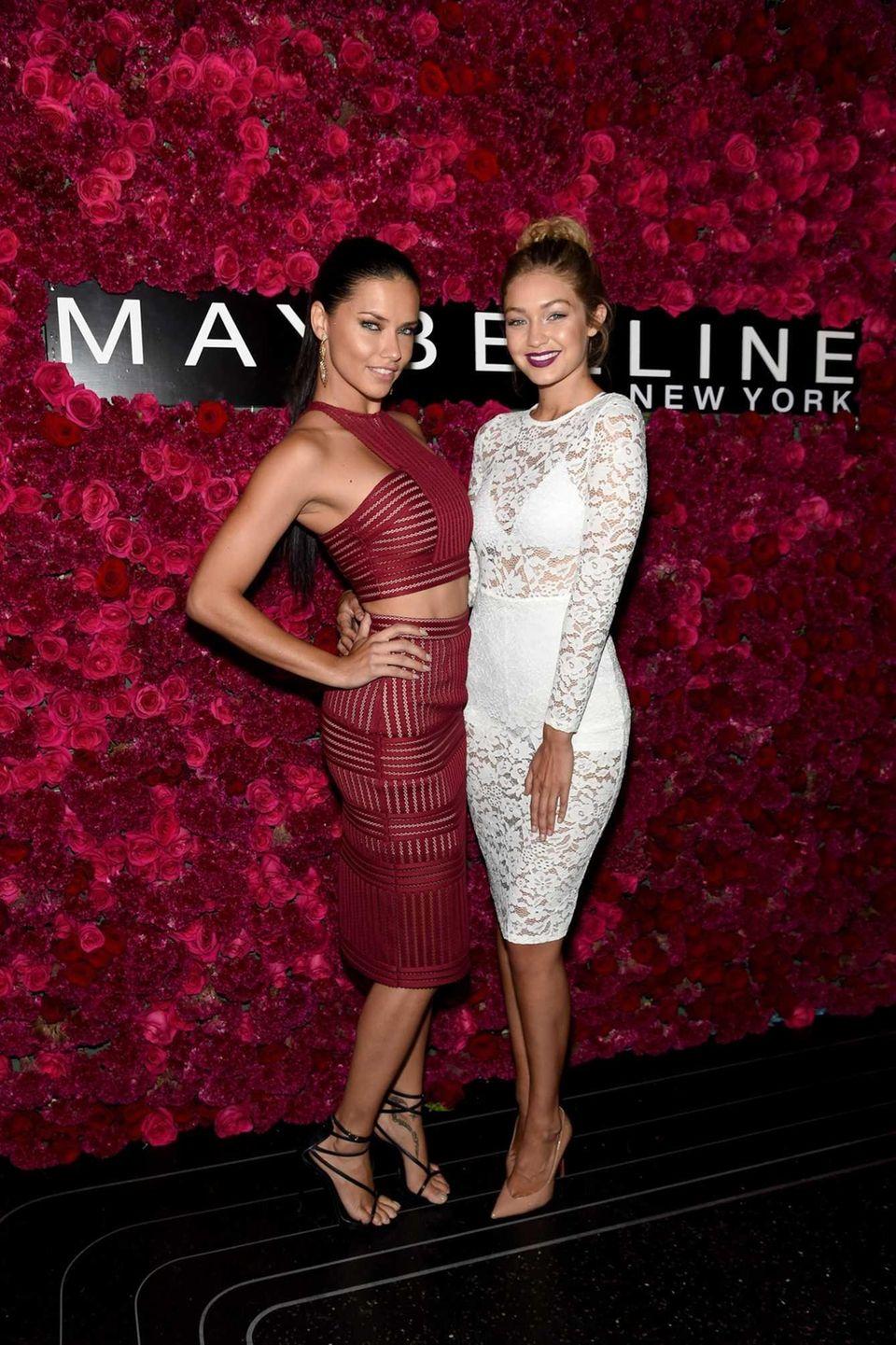 Models Adriana Lima, left, and Gigi Hadid attend
