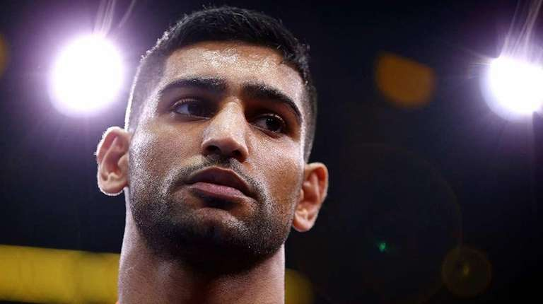 Amir Khan looks on before his welterweight fight