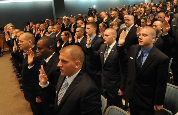 Suffolk County Police recruits are sworn in at