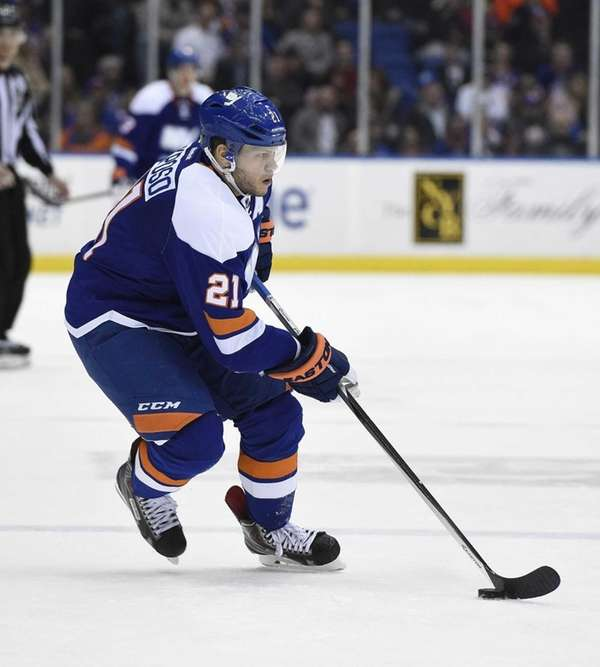 New York Islanders right wing Kyle Okposo skates