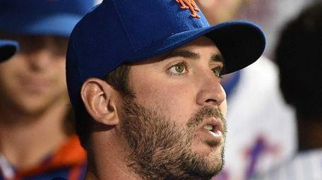 New York Mets pitcher Matt Harvey looks on