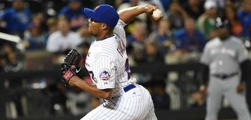 New York Mets relief pitcher Jeurys Familia delivers