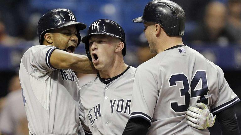 The New York Yankees' Slade Heathcott, center, celebrates
