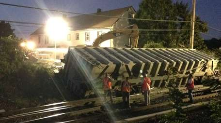 Track crews work into the night to clear