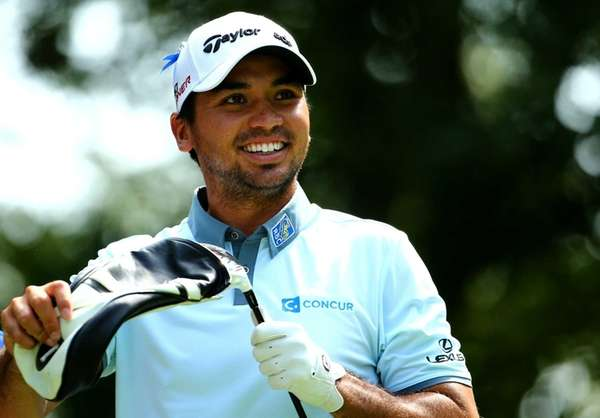 Jason Day of Australia stands on the ninth
