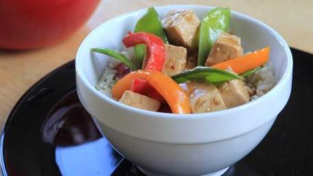 Stir-fried red and orange peppers, snow peas and