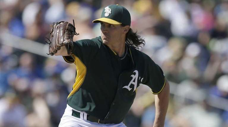 Oakland Athletics pitcher Barry Zito works against the