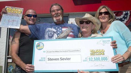 Lottery winner Steven Sevier, center left, with is