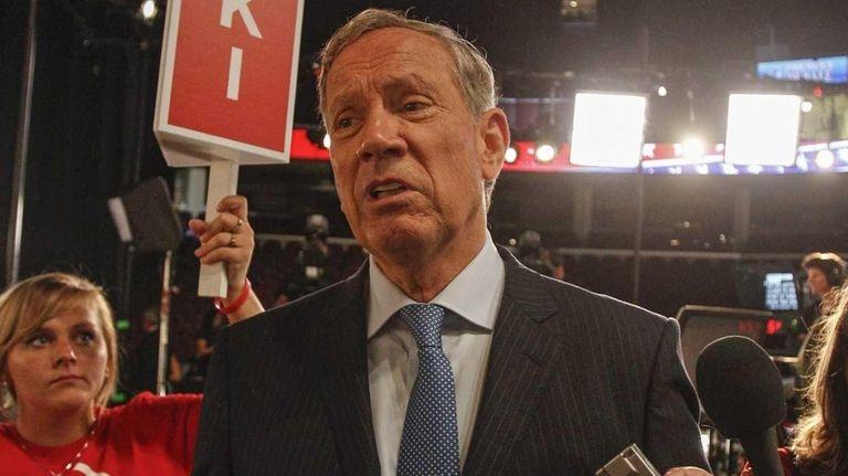 Former New York Gov. George Pataki leaves the