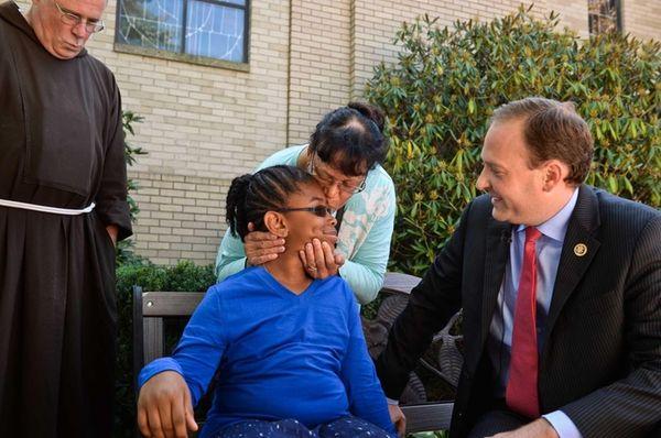 Louisa Lopeztaitt, 10, of Brookhaven, receives a kiss