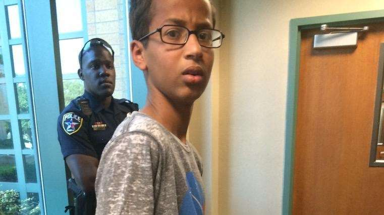 Ahmed Mohamed being led away in handcuffs after