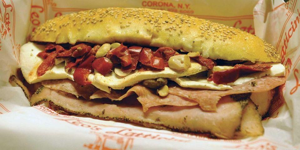 (n) An oversized sandwich on a long roll,