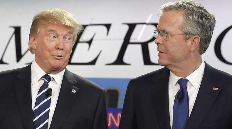 Republican presidential candidates, businessman Donald Trump, left, and