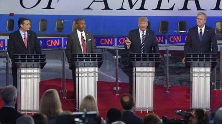 Republican presidential candidates Ted Cruz, left, Ben Carson,