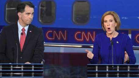 Republican presidential candidate, businesswoman Carly Fiorina, right, speaks
