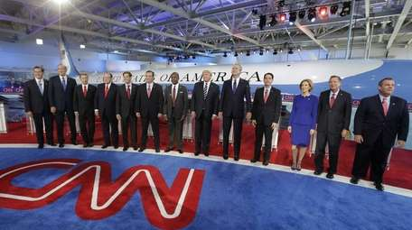 Republican presidential candidates take the stage during the