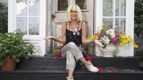 Fashion icon Betsey Johnson on the front steps