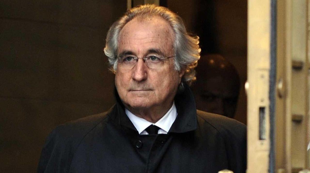 Bernard Madoff leaves court after a hearing regarding