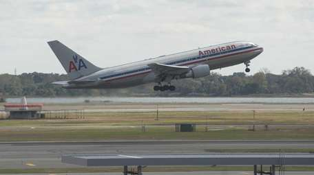 An American Airlines plane is shown leaving Kennedy