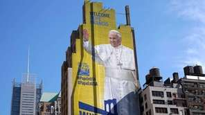 A huge portrait of Pope Francis is seen