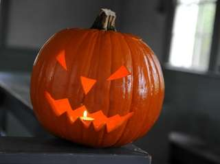 A Jack O'Lantern just carved in the schoolhouse