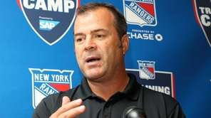 Rangers head coach Alain Vigneault holds a news