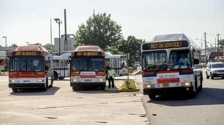 NICE buses sit at headquarters in Garden City,