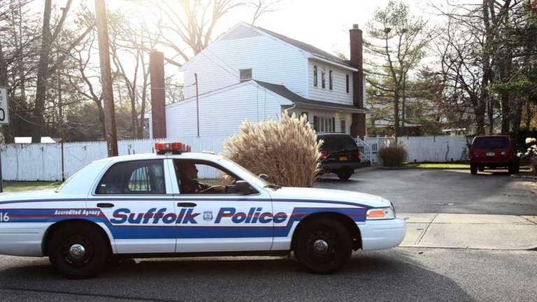 A Suffolk police car sits in front of