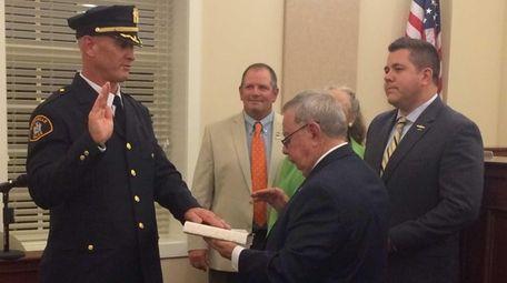 Amityville Mayor James Wandell swears in Police Chief