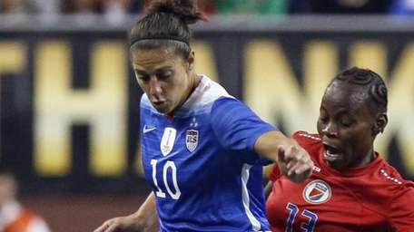 Carli Lloyd of the United States tries to