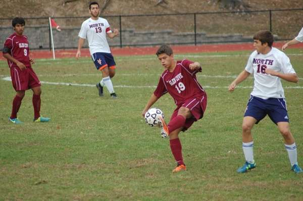 Glen Cove's Delwin Hernandez plays the ball in
