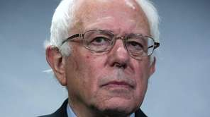 U.S. Sen. Bernie Sanders (I-Vt.) listens during a