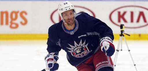 New York Rangers forward Dominic Moore skates during