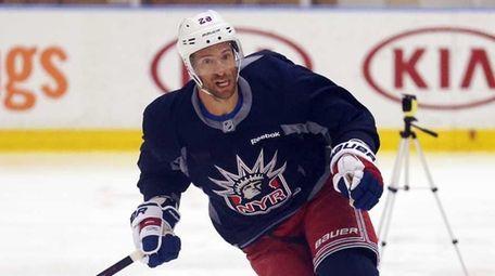 New York Rangers forward Dominic Moore skates during