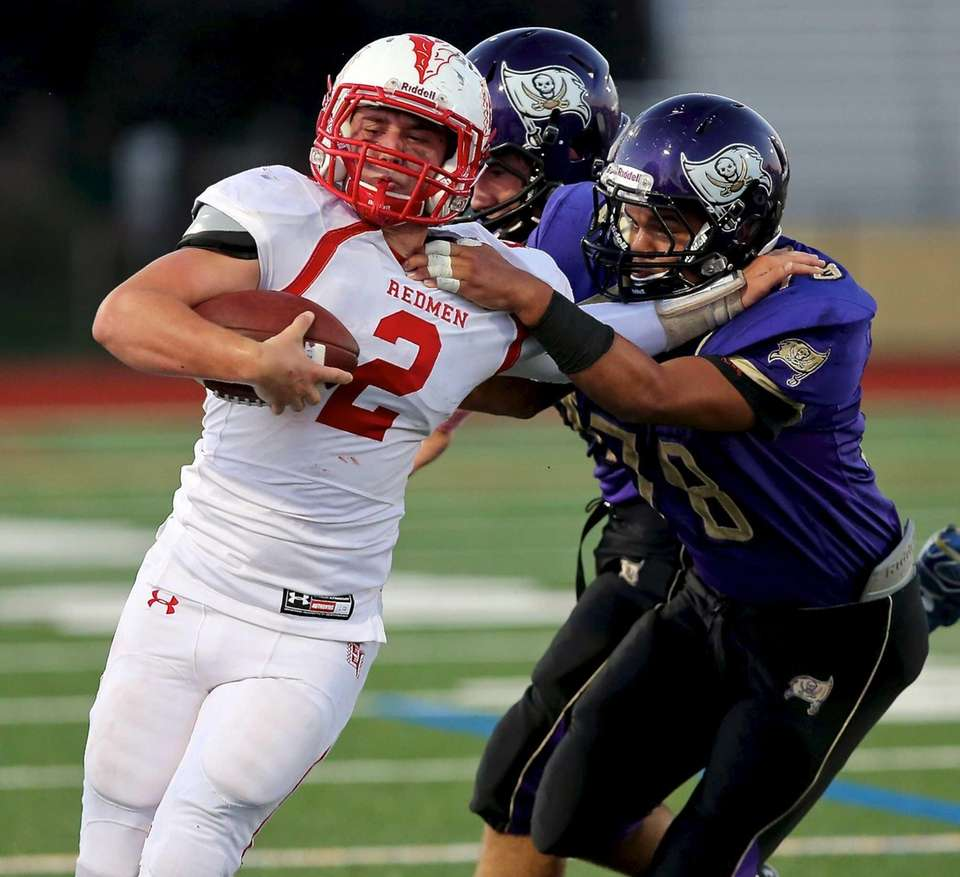 East Islip QB Jack Hannigan gets tackled by