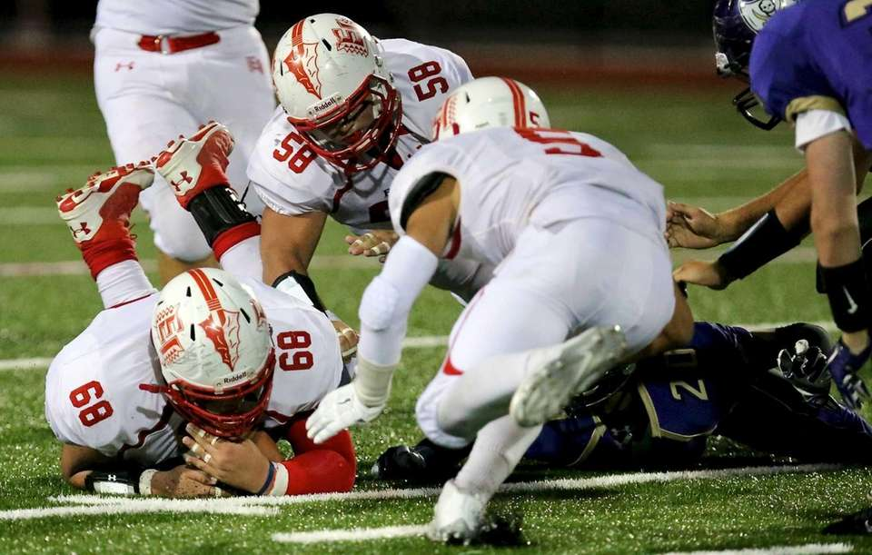 East Islip DT Kyle Nunez grabs the Islip