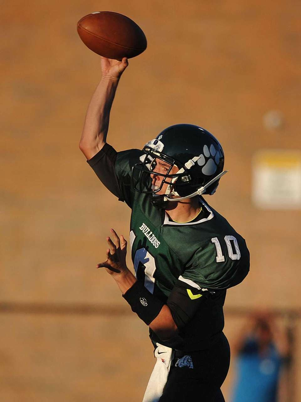 Lindenhurst quarterback Ryan Hofmann throws a pass during