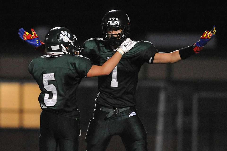 Lindenhurst linebacker Jeremy Ruckert, right, gets congratulated by
