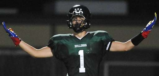 Lindenhurst's Jeremy Ruckert reacts after recording a sack