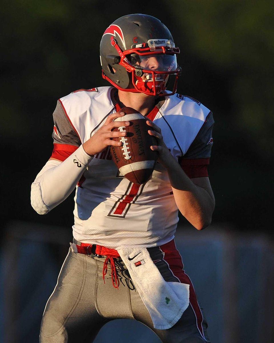 Connetquot quarterback Jack Cassidy looks for an open