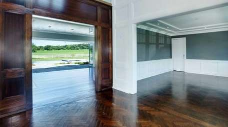 A newly constructed Old Westbury home nestled at