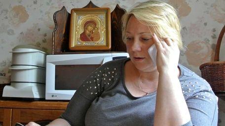 Alla Kravtsova speaks on a phone at her