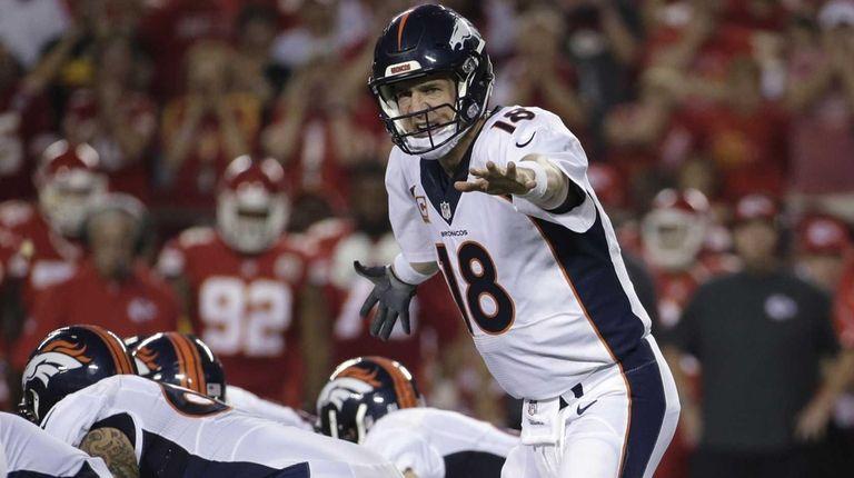 Denver Broncos quarterback Peyton Manning (18) calls a