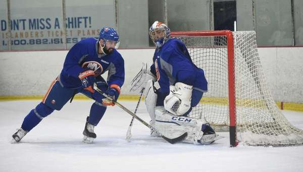 New York Islanders defender Nick Leddy and goalie